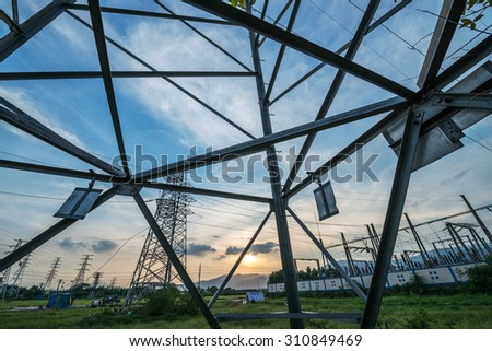 high-voltage substation on blue sky background - stock photo