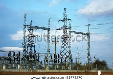 High-voltage substation on blue sky background with switch and dis-connector - stock photo