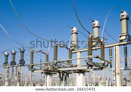 high-voltage substation on blue sky background with switch and disconnector