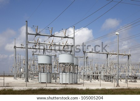 High Voltage Substation with the Blue Sky Background.