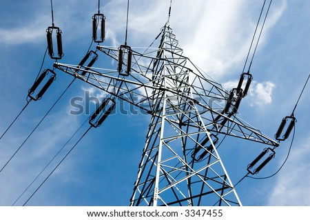 High voltage tower against a blue sky with clouds - stock photo
