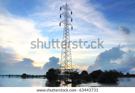 High voltage tower and sun set - stock photo