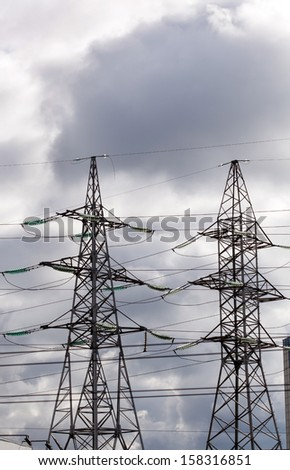 High voltage tower at sky - stock photo