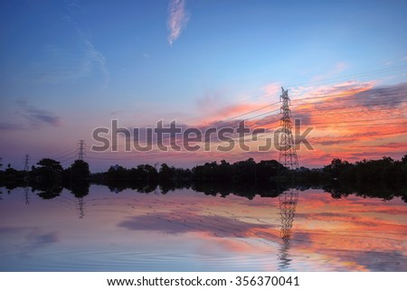 High-voltage tower at twilight with blue hour at dusk