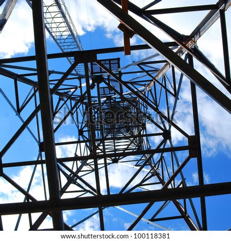 high-voltage tower on blue sky background - stock photo