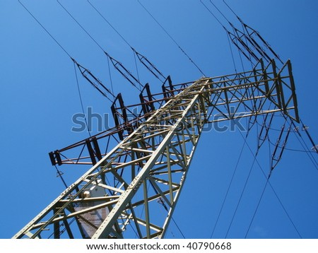 High voltage tower on blue sky background