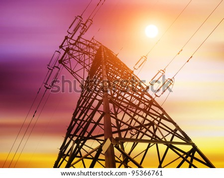 High-voltage tower silhouette dusk