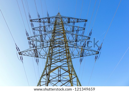 High-voltage tower with blue sky background