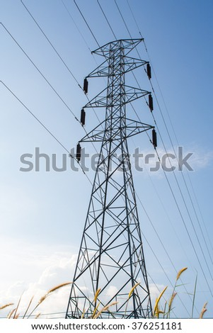 high voltage tower with blue sky background