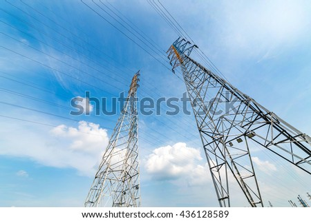 High voltage towers in the blue sky white cloud background
