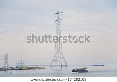 High voltage towers in the sea. Netherlands.