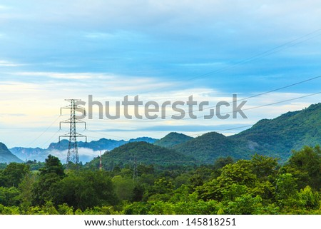 High voltage towers on mountain - stock photo