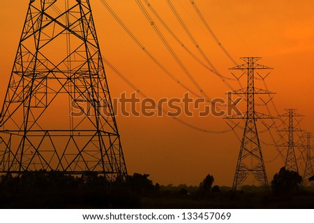 High voltage towers on the sunset in Thailand - stock photo