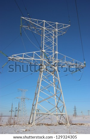 High voltage towers. winter - stock photo