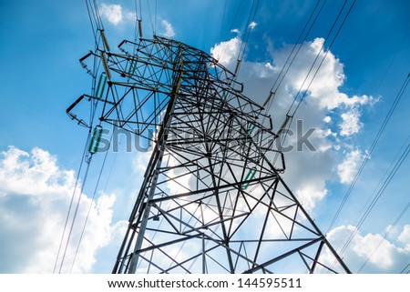 High voltage towers with sky background. - stock photo