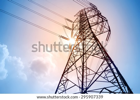 High voltage towers with sky background