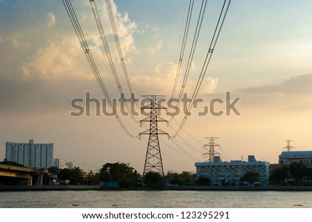 high voltage towers with sunset sky
