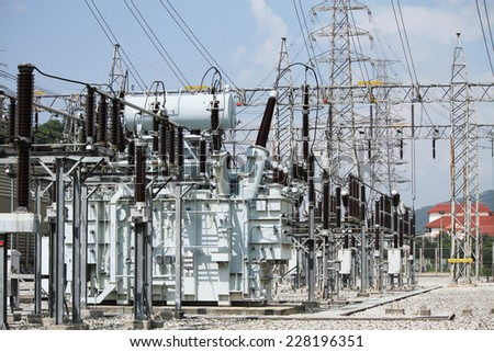 High voltage transformer in outdoor switchgear. - stock photo