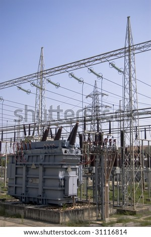 High voltage transformer in sub station - stock photo