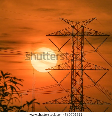 High voltage transmission lines. Electric poke.background at sunset