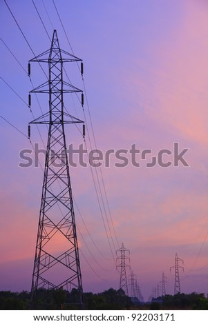 High voltage transmission towers. - stock photo