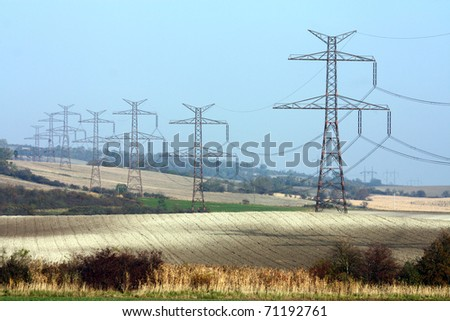 high voltage transmission towers in line - stock photo