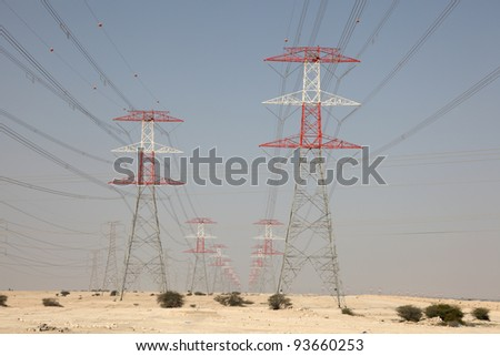 High voltage transmission towers in the desert of Qatar - stock photo