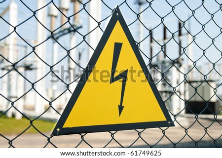 high voltage warning sign on high-voltage substation - stock photo