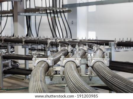 High voltage wireway in power station building - stock photo