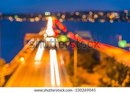 high way at night time,i-90 from seattle to Mercer lsland,WA,USA.-blur. - stock photo