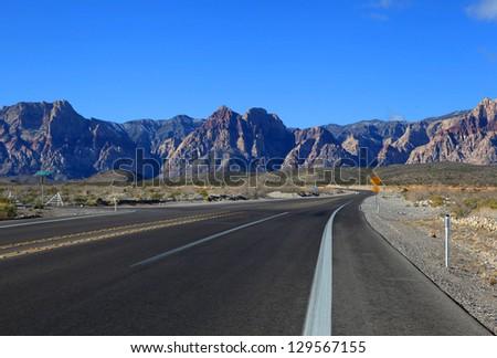 High way through red rock canyon - stock photo