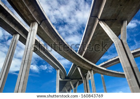 High way under cloudy sky - stock photo