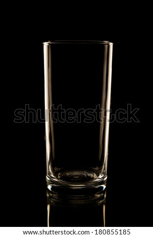Highball glass in the low-key lighting and surface reflection - stock photo