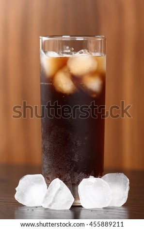 Highball glass with cola and ice cubes