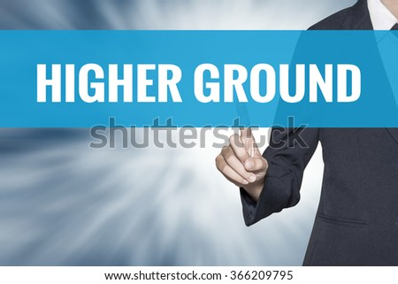 Higher Ground word on virtual screen touch by business woman cyan sky tab - stock photo