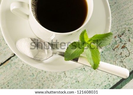 Highkey image of a cup of coffee with natural sweetener stevia - stock photo