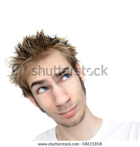 Highkey portrait of a young man staring ahead with isolated white copyspace above and on both sides, pondering. - stock photo