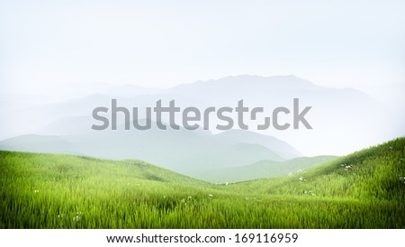 Highland Alpine meadow with hazy mountains in the background - stock photo