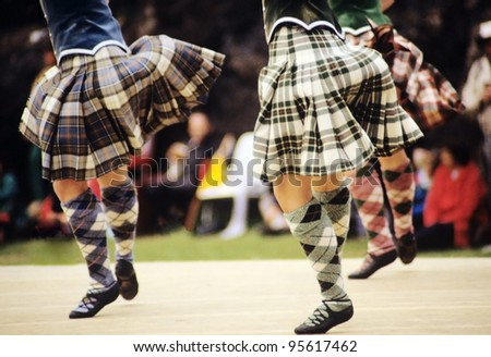 highland dancers at a highland games in scotland, uk - stock photo