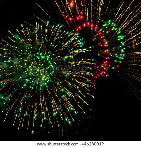 Highlight at the end of the year; Colorful firework display; Pyrotechnics; Explosions against black night sky; Happy New Year - stock photo
