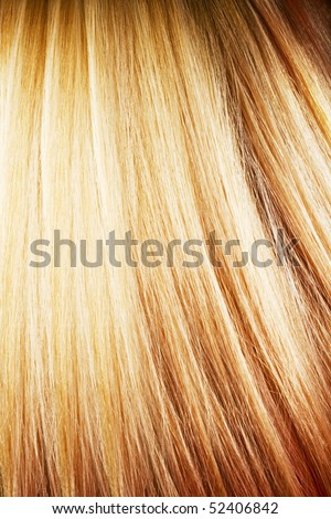 Highlighted coloured hair closeup - stock photo