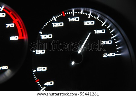 highlighted speedometer in the process of a car ride - stock photo