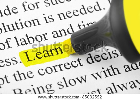 Highlighter and word Learn (my original text) - concept education background - stock photo