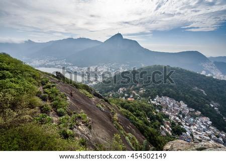 Highline and slackline adventures over Morro dos Cabritos in Rio de Janeiro, Brazil - stock photo
