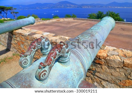 Highly decorated handles of a bronze canon in Saint Tropez fortress, French Riviera, France - stock photo