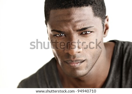 Highly detail portrait of young good looking man staring at viewer against white neutral background - stock photo