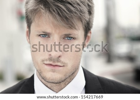 Highly detailed close up portrait of a handsome young stylish man - stock photo