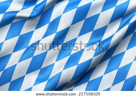 Highly detailed flag of Bavaria waving in the wind. Light blue sky is shining through the fabric texture. - stock photo