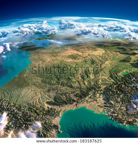 Highly detailed fragments of the planet Earth with exaggerated relief, translucent ocean and clouds, illuminated by the morning sun. France. Elements of this image furnished by NASA - stock photo