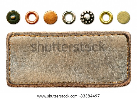 Highly detailed grungy blank natural leather jeans label with set of worn metal rivets, isolated on white background - stock photo